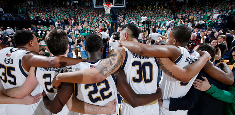Notre Dame Fighting Irish players celebrate arm in arm after the game against the Duke Blue Devils at Purcell Pavilion on January 28, 2015 in South Bend, Indiana. Notre Dame defeated Duke 77-73. (Getty)