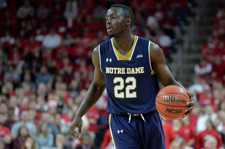 Jerian Grant #22 of the Notre Dame Fighting Irish moves the ball against the North Carolina State Wolfpack during their game at PNC Arena on January 25, 2015 in Raleigh, North Carolina. Notre Dame won 81-78 in overtime. (Getty)
