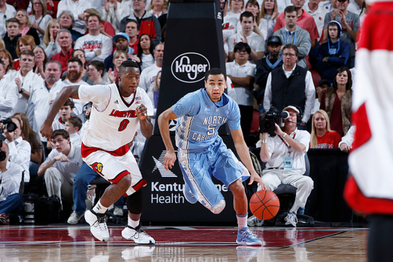 Marcus Paige #5 of the North Carolina Tar Heels brings the ball up court against Terry Rozier #0 of the Louisville Cardinals during the game at KFC Yum! Center on January 31, 2015 in Louisville, Kentucky. Louisville defeated North Carolina 78-68 in overtime. (Getty)