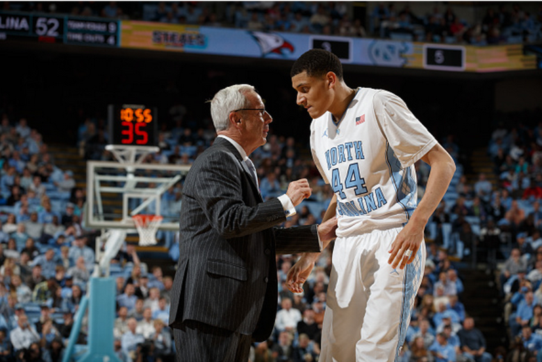 Head coach Roy Williams of the North Carolina Tar Heels coaches Justin Jackson #44 during a game against the North Carolina Central Eagles on November 14, 2014 at the Dean E. Smith Center in Chapel Hill, North Carolina. North Carolina won 60-76. (Getty)