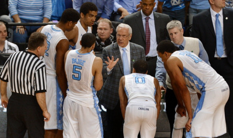 North Carolina head coach Roy Williams sets up the Tar Heels' final possession in an 80-75 loss against Pittsburgh in the quarterfinals of the ACC Tournament on Friday, March 14, 2014, in Greensboro, N.C. Pitt advanced, 80-75. (Getty)