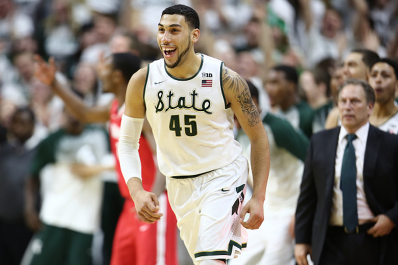 Denzel Valentine #45 of the Michigan State Spartans celebrates after making the game winning three during the game against the Ohio State Buckeyes at the Breslin Center on February 14, 2015 in East Lansing, Michigan. (Getty)