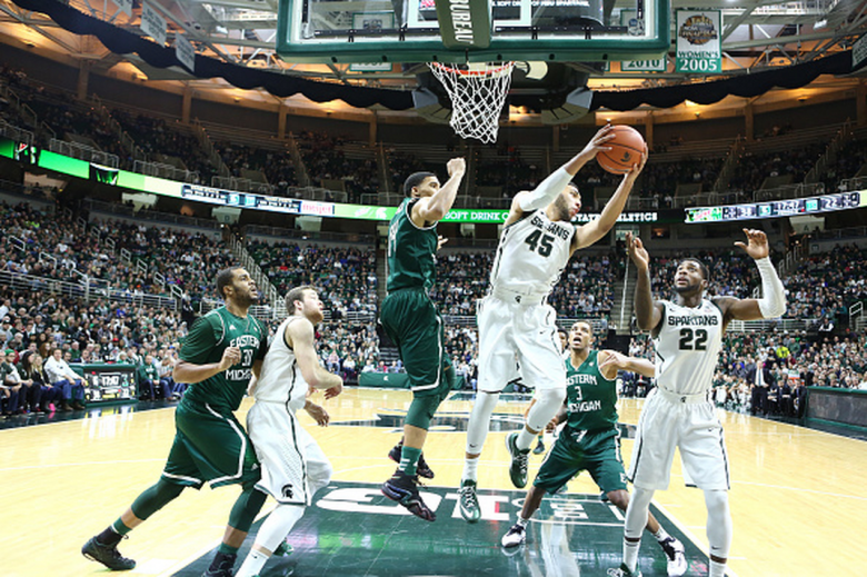 Denzel Valentine #45 of the Michigan State Spartans grabs a rebound in the second half against the Eastern Michigan Eagles at the Breslin Center on December 17, 2014 in East Lansing, Michigan. (Getty)