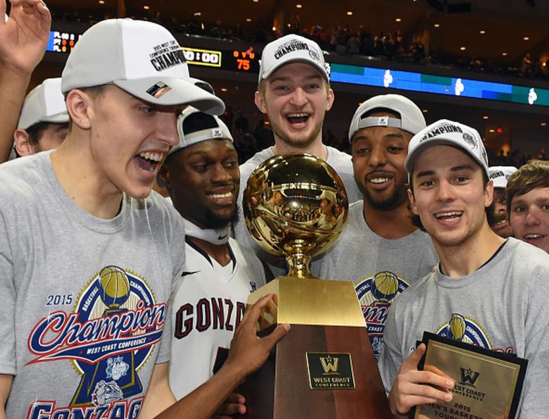 Kyle Wiltjer #33, Gary Bell Jr. #5, Domantas Sabonis #11, Byron Wesley #22 and Kevin Pangos #4 of the Gonzaga Bulldogs celebrate with the trophy after defeating the Brigham Young Cougars 91-75 to win the championship game of the West Coast Conference Basketball tournament at the Orleans Arena on March 10, 2015 in Las Vegas, Nevada. (Getty)