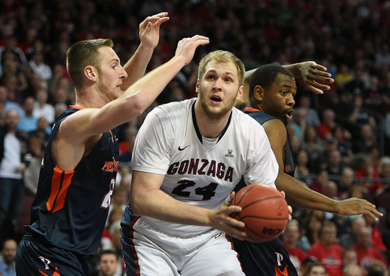 Przemek Karnowski #24 of the Gonzaga Bulldogs drives to the basket against Nate Gehring #22 (L) and Stacy Davis #5 of the Pepperdine Waves during a semifinal game of the West Coast Conference Basketball tournament at the Orleans Arena on March 9, 2015 in Las Vegas, Nevada. Gonzaga won 79-61. (Getty)