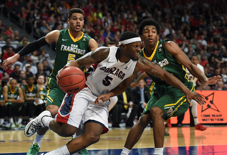 Gary Bell Jr. #5 of the Gonzaga Bulldogs breaks a press by Matt Glover #5 and Devin Watson #21 of the San Francisco Dons during a quarterfinal game of the West Coast Conference Basketball tournament at the Orleans Arena on March 7, 2015 in Las Vegas, Nevada. Gonzaga won 81-72. (Getty)