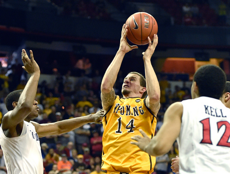Josh Adams #14 of the Wyoming Cowboys shoots against the San Diego State Aztecs during the championship game of the Mountain West Conference basketball tournament at the Thomas & Mack Center on March 14, 2015 in Las Vegas, Nevada. Wyoming won 45-43. (Getty)