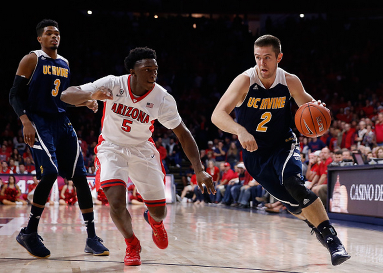 Travis Souza #2 of the UC Irvine Anteaters dirves the ball past Stanley Johnson #5 of the Arizona Wildcats during the college basketball game at McKale Center on November 19, 2014 in Tucson, Arizona. The Wildcats defeated the Anteaters 71-54. (Getty)