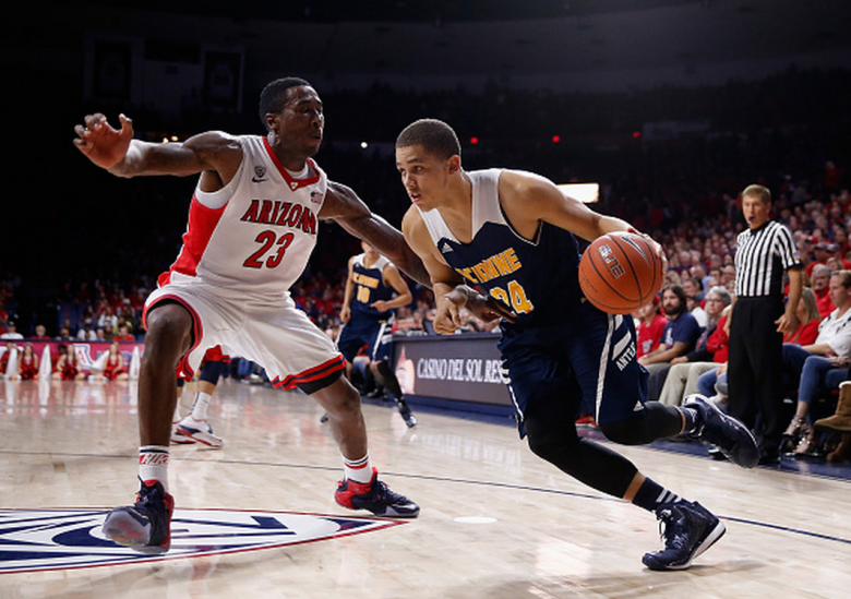 Dominique Dunning #24 of the UC Irvine Anteaters drives the ball past Rondae Hollis-Jefferson #23 of the Arizona Wildcats during the college basketball game at McKale Center on November 19, 2014 in Tucson, Arizona. The Wildcats defeated the Anteaters 71-54. (Getty)