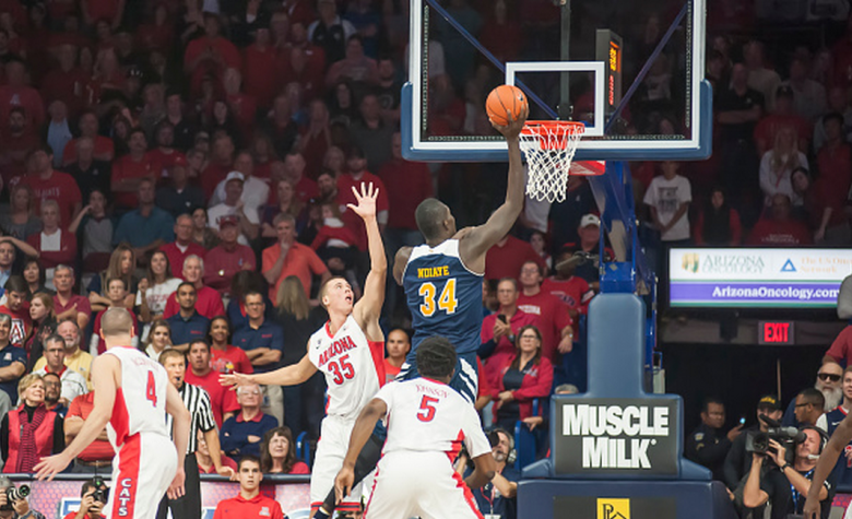 Center Mamadou Ndiaye #34 of the UC Irvine Anteaters scores while being defended by center Kaleb Tarczewski #35 of the Arizona Wildcats at McKale Center on November 19, 2014 in Tucson, Arizona. (Getty)