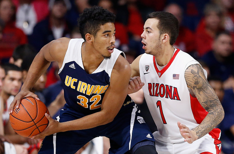 Aaron Wright #32 of the UC Irvine Anteaters looks to pass around Gabe York #1 of the Arizona Wildcats during the first half of the college basketball game at McKale Center on November 19, 2014 in Tucson, Arizona. (Getty)