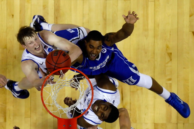 Kyle Singler #12 and Kyrie Irving #1 of the Duke Blue Devils battle Koron Reed #33 of the Hampton Pirates for a rebound during the second round of the 2011 NCAA men's basketball tournament at Time Warner Cable Arena on March 18, 2011 in Charlotte, North Carolina. (Getty)