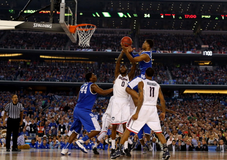 Andrew Harrison #5 of the Kentucky Wildcats goes to the basket against the Connecticut Huskies during the NCAA Men's Final Four Championship at AT&T Stadium on April 7, 2014 in Arlington, Texas. (Getty)