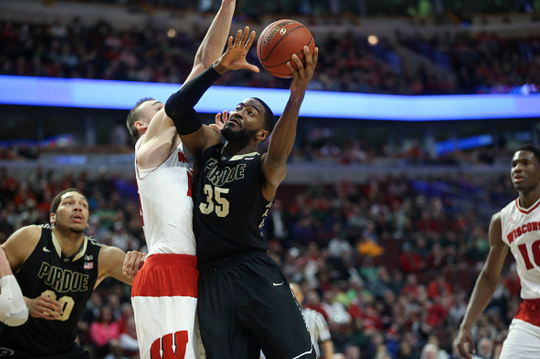 Purdue's Rapheal Davis (35) puts up a shot against Wisconsin's Sam Dekker during the first half in the semfinals of the Big Ten Tournament at the United Center in Chicago on Saturday, March 14, 2015. Wisconsin advanced, 71-51. (Getty)