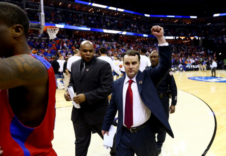 Head coach Archie Miller of the Dayton Flyers celebrates after defeating the Stanford Cardinal 82-72 in a regional semifinal of the 2014 NCAA Men's Basketball Tournament at the FedExForum on March 27, 2014 in Memphis, Tennessee. (Getty)
