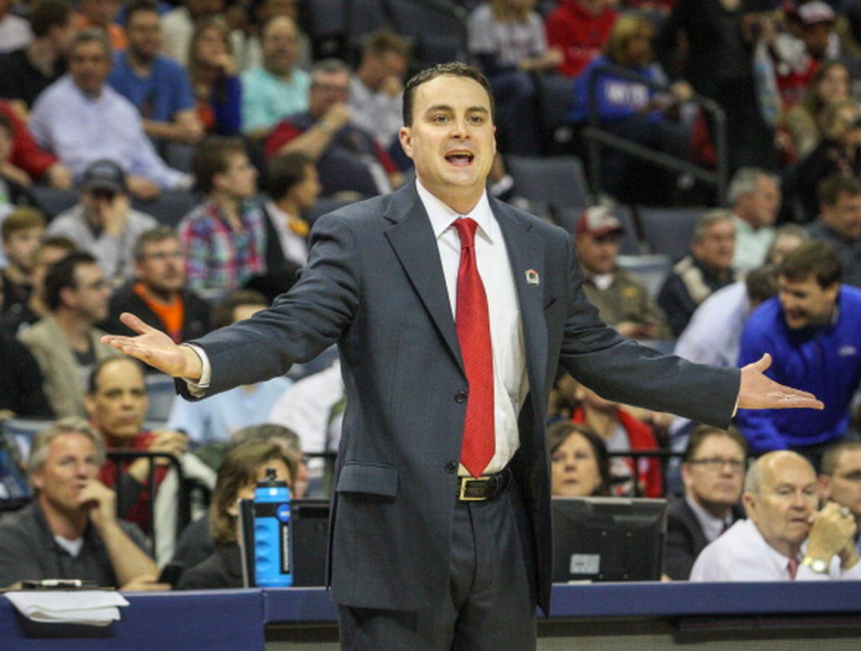 Dayton Flyers coach Archie Miller reacts during first-half action in the NCAA Tournament's Sweet 16 game against the Stanford Cardinal at FedExForum in Memphis, Tenn., on Thursday, March 27, 2014. (Getty)