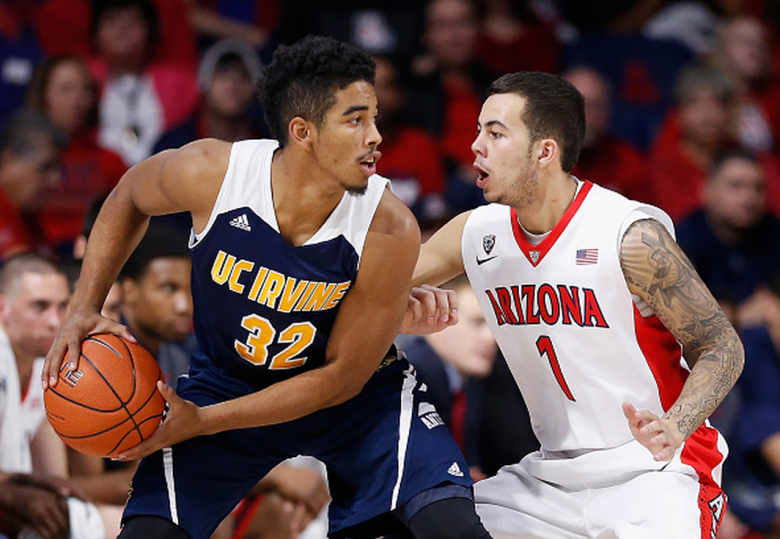 Aaron Wright #32 of the UC Irvine Anteaters looks to pass around Gabe York #1 of the Arizona Wildcats 1during the college basketball game at McKale Center on November 19, 2014 in Tucson, Arizona. The Wildcats defeated the Anteaters 71-54. (Getty)