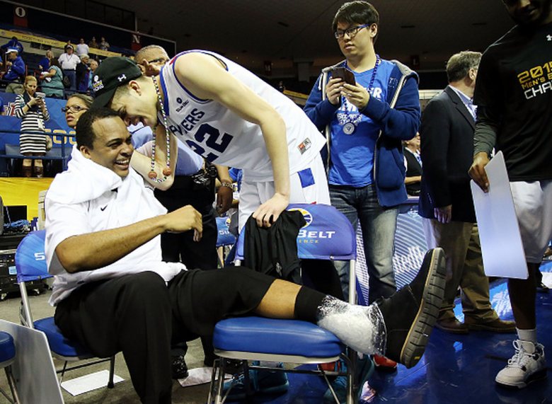 R.J. Hunter #22 of the Georgia State Panthers celebrates with his father head coach Ron Hunter of the Georgia State Panthers after defeating the Georgia Southern Eagles to win the Sun Belt Conference Men's Championship game at the UNO Lakefront Arena on March 15, 2015 in New Orleans, Louisiana. (Getty)