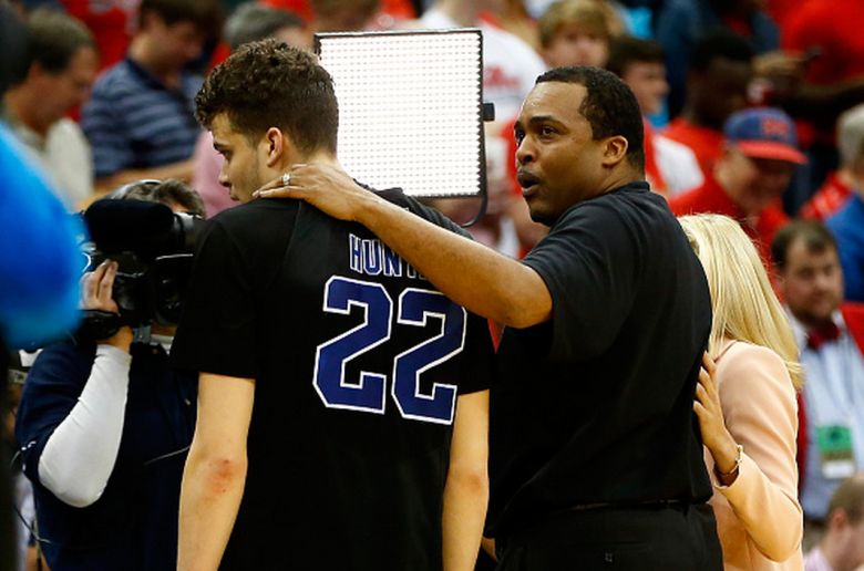 Head coach Ron Hunter of the Georgia State Panthers puts his arm around son and player R.J. Hunter #22 after the Panthers 57-56 win against the Baylor Bears during the second round of the 2015 NCAA Men's Basketball Tournament at Jacksonville Veterans Memorial Arena on March 19, 2015 in Jacksonville, Florida. (Getty)