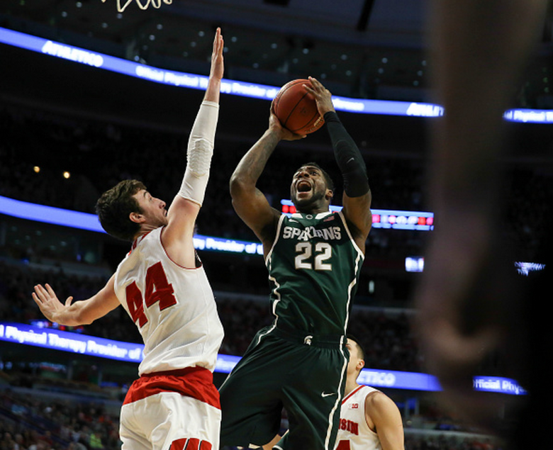 Michigan State Spartans guard/forward Branden Dawson (22) goes to the basket against Wisconsin Badgers forward Frank Kaminsky (44) during the first half of their Big Ten Men's Tournament championship game on Sunday, March 15, 2015, at the United Center in Chicago. (Getty)