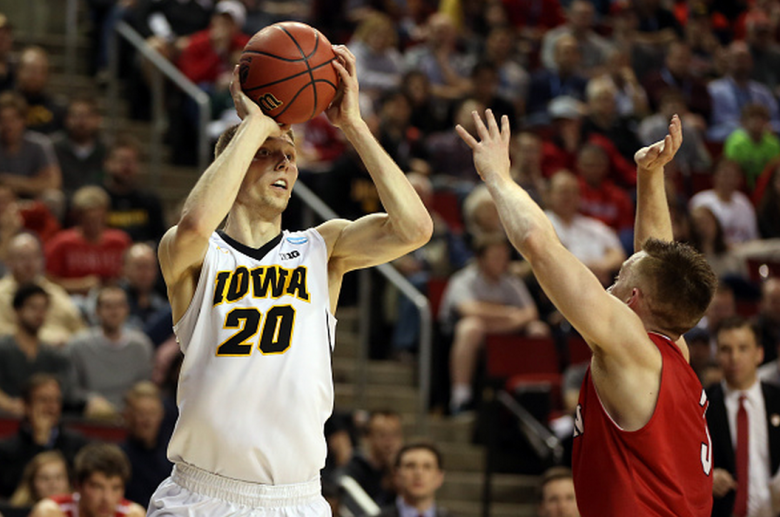 Jarrod Uthoff #20 of the Iowa Hawkeyes shoots the ball against Brian Sullivan #3 of the Davidson Wildcats during the second round of the 2015 NCAA Men's Basketball Tournament at KeyArena on March 20, 2015 in Seattle, Washington. (Getty)