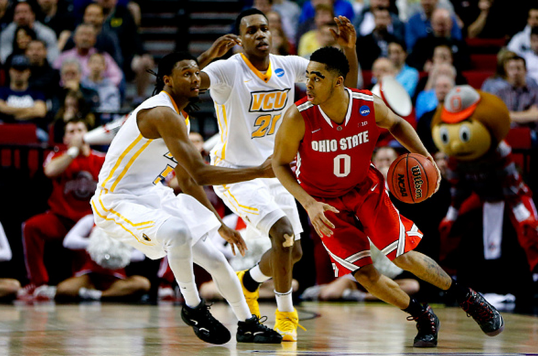 D'Angelo Russell #0 of the Ohio State Buckeyes eludesDoug Brooks #5 of the Virginia Commonwealth Rams in overtime during the second round of the 2015 NCAA Men's Basketball Tournament at Moda Center on March 19, 2015 in Portland, Oregon. (Getty)
