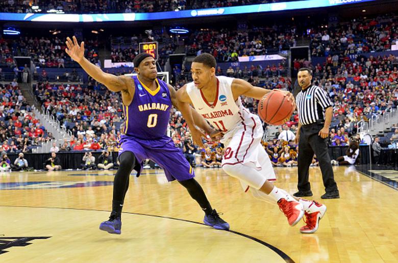 Oklahoma's Isaiah Cousins drives around Albany's Evan Singletary in the 2015 NCAA Men's Basketball Tournament. (Getty)