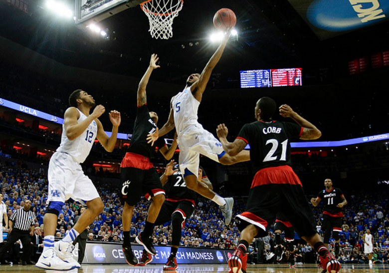 Kentucky's Andrew Harrison drives in for the basket and a foul as the Wildcats defeated Cincinnati, 64-51, in the third round of the NCAA Tournament. (Getty)