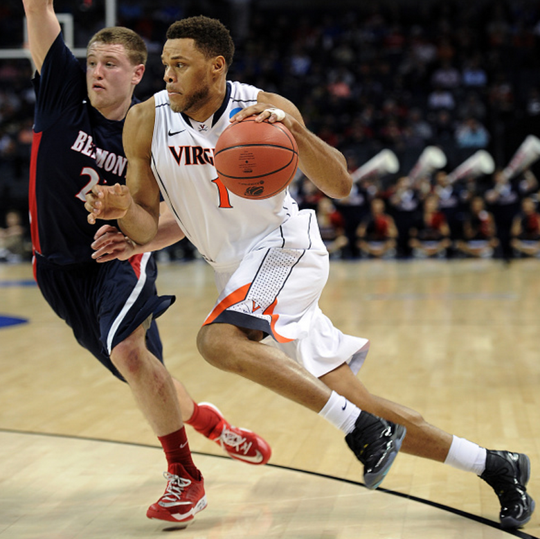 Virginia's Justin Anderson drives against the Belmont Bruins during the second round of the 2015 NCAA Men's Basketball Tournament. (Getty)