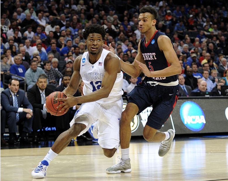 Duke's Justise Winslow drives against robert Morris' Elijah Minnie during the second round of the 2015 NCAA Men's Basketball Tournament. (Getty)
