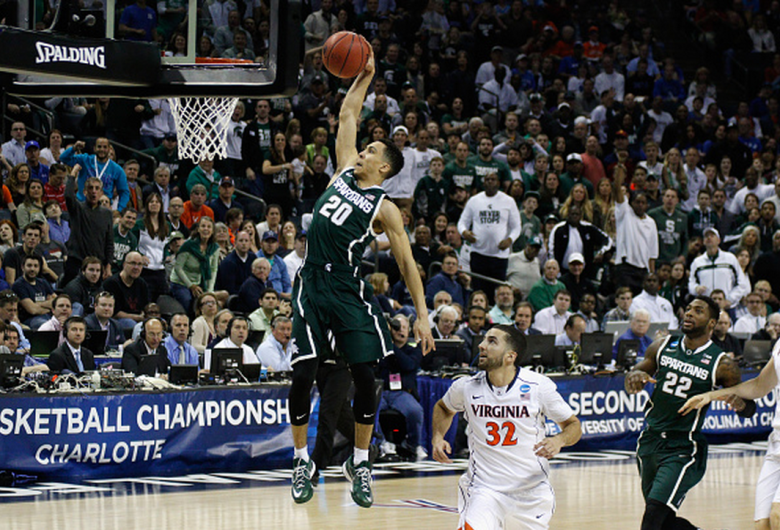 Michigan State's Travis Trice drives to the basket against the Virginia Cavaliers during the third round of the 2015 NCAA Men's Basketball Tournament. (Getty)