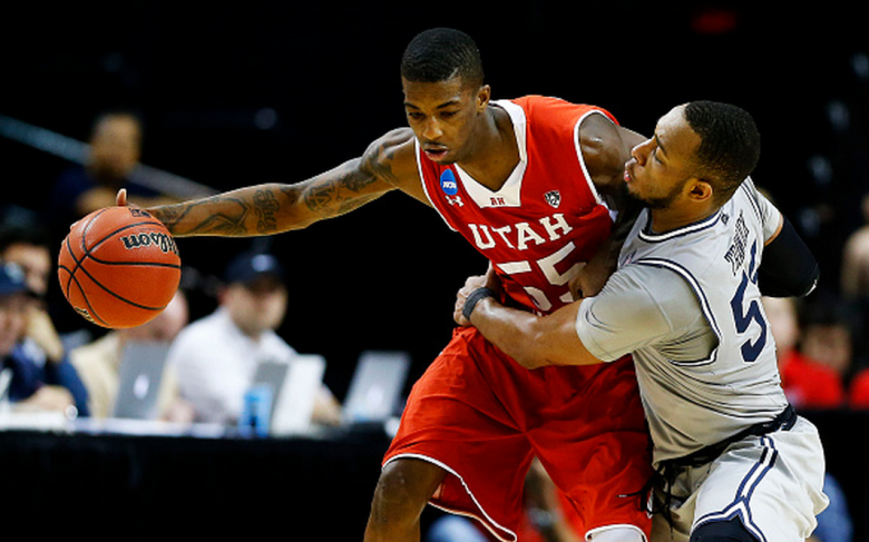 Utah's Delon Wright drives against Georgetown's Jabril Trawick in the 2015 NCAA Men's Basketball Tournament. (Getty)