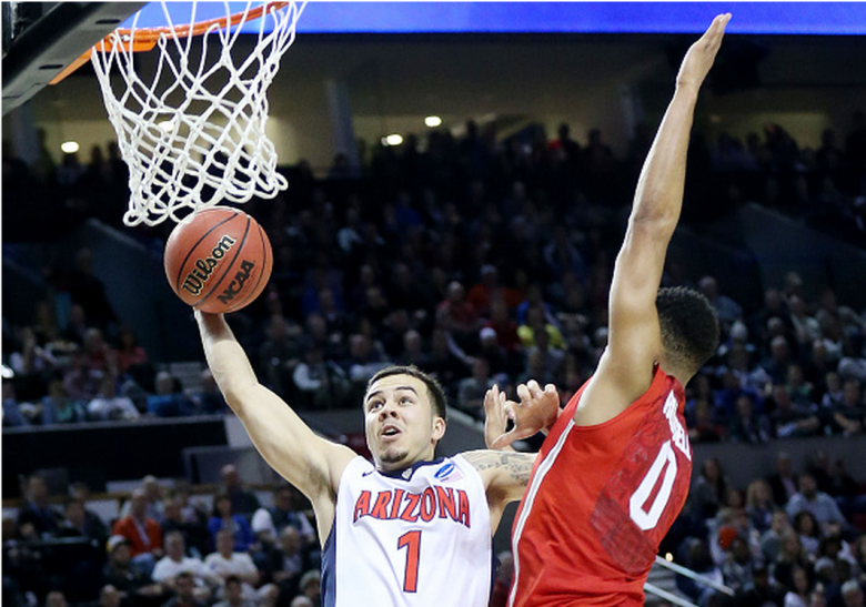 Arizona's Gabe York goes up against Ohio State's D'Angelo Russell in the 2015 NCAA Men's Basketball Tournament. (Getty)