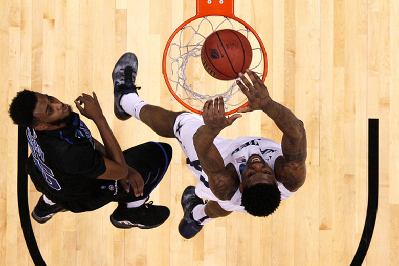 Xavier's Jalen Reynolds dunks on Georgia State's Ryan Harrow during the 2015 NCAA Men's Basketball Tournament. (Getty)