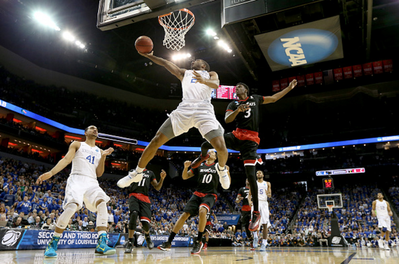 Kentucky's Aaron Harrison drives to the basket past Cincinnati's Shaquille Thomas during the 2015 NCAA Men's Basketball Tournament. (Getty)