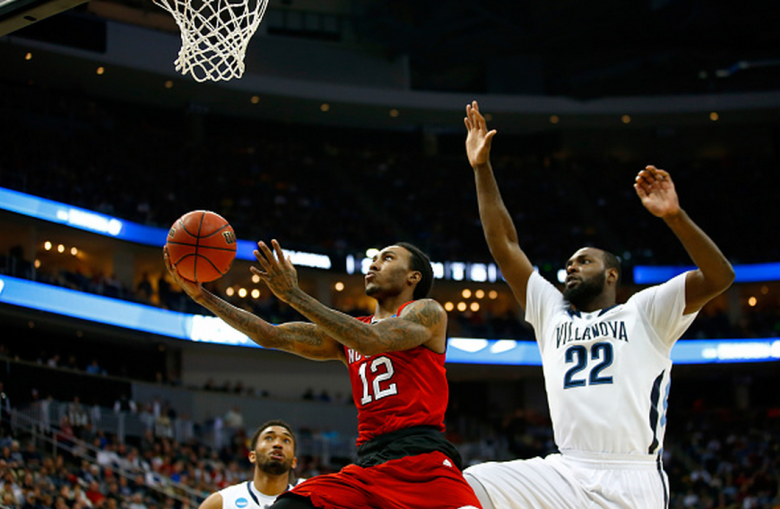NC State's Anthony Barber puts up a shot in front of Villanova's JayVaughn Pinkston in the 2015 NCAA Men's Basketball Tournament. (Getty)