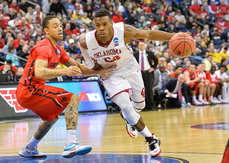 Oklahoma's Buddy Hield controls the ball against the Dayton Flyers during the 2015 NCAA Men's Basketball Tournament. (Getty)