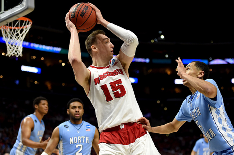 Wisconsin's Sam Dekker with the ball against North Carolina's Marcus Paige in the 2015 NCAA Men's Basketball Tournament. (Getty)