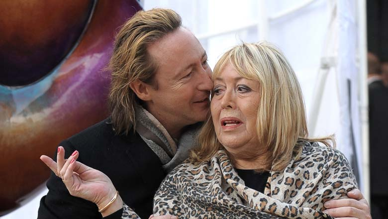 Cynthia pictured with her son, Julian, in 2010. (Getty)