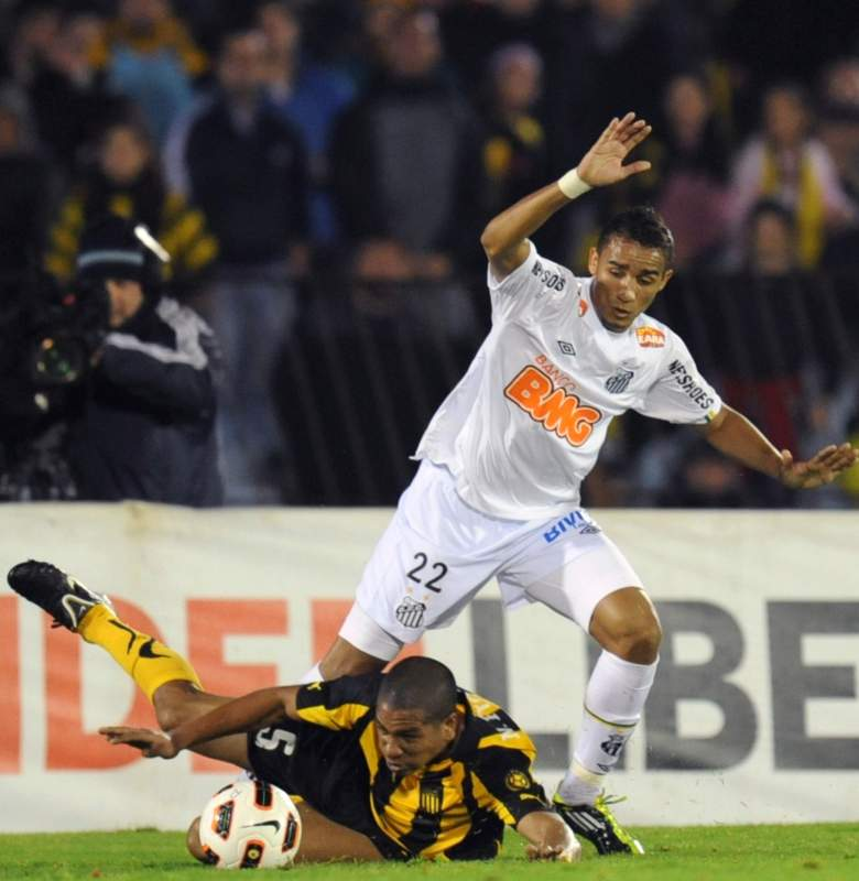 Danillo, top, goes for the ball against a Penarol player during the final of the 2011 Copa Libertadores. Santos would win the competition for the first time since 1963. (Getty)