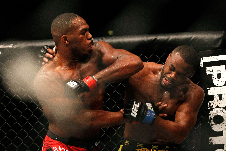Jon Jones, left, fights Rashad Evans in 2012. (Getty)