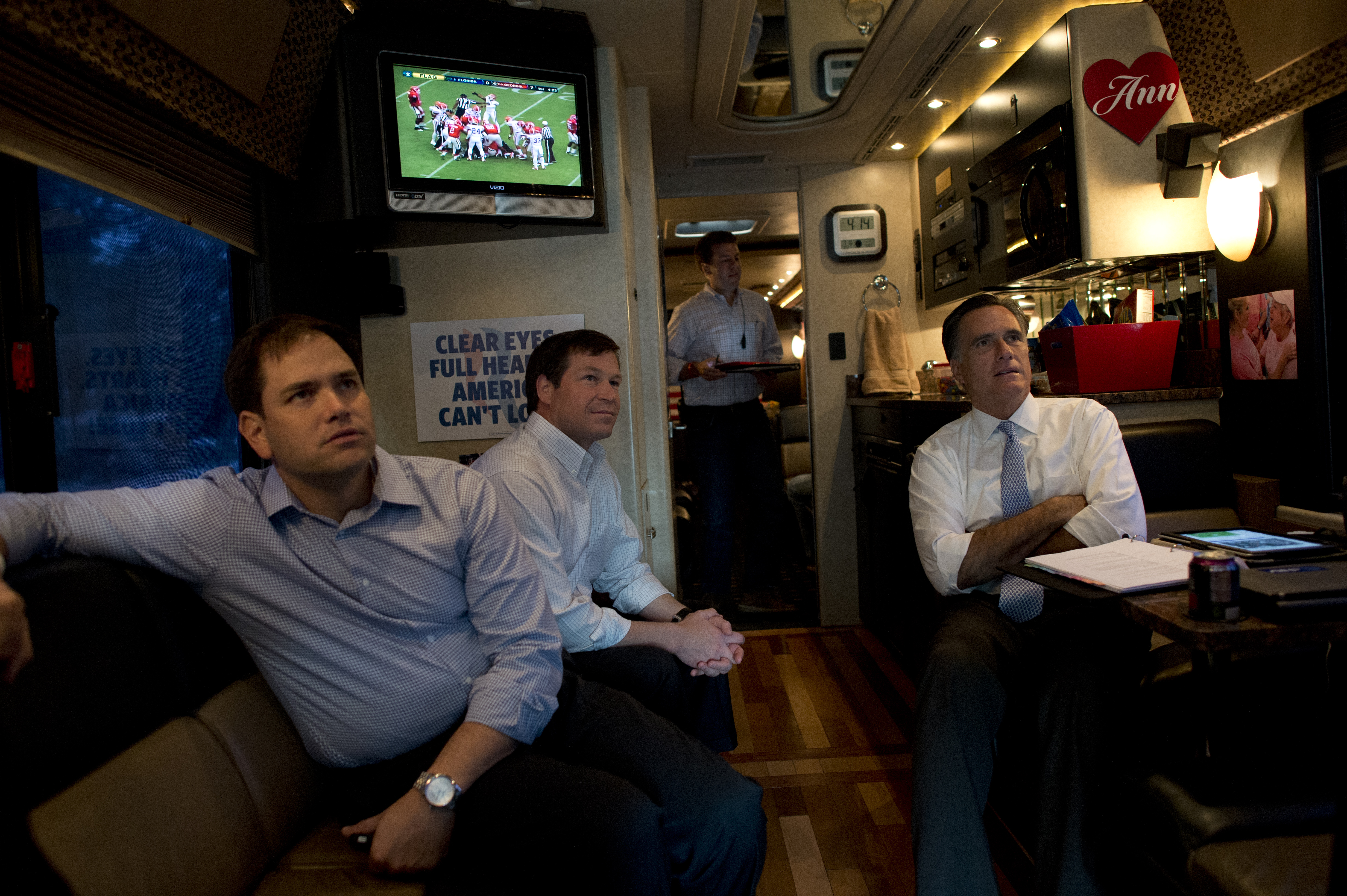 Senator Marco Rubio watches football with Mitt Romney and Congressman Connie Mack on Romney's campaign bus in 2012. (Getty)