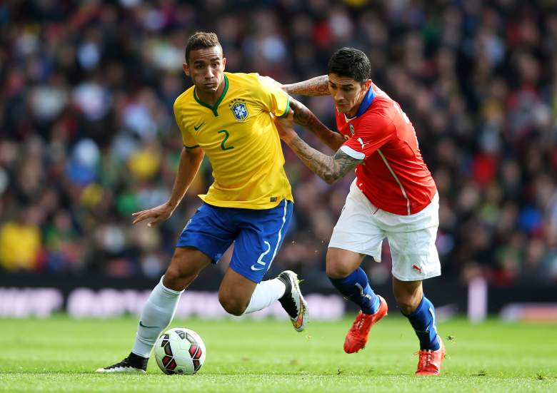 Danilo, left, appears in a game for Brazil against Chile March 29. Danilo has 13 caps for his country. (Getty)