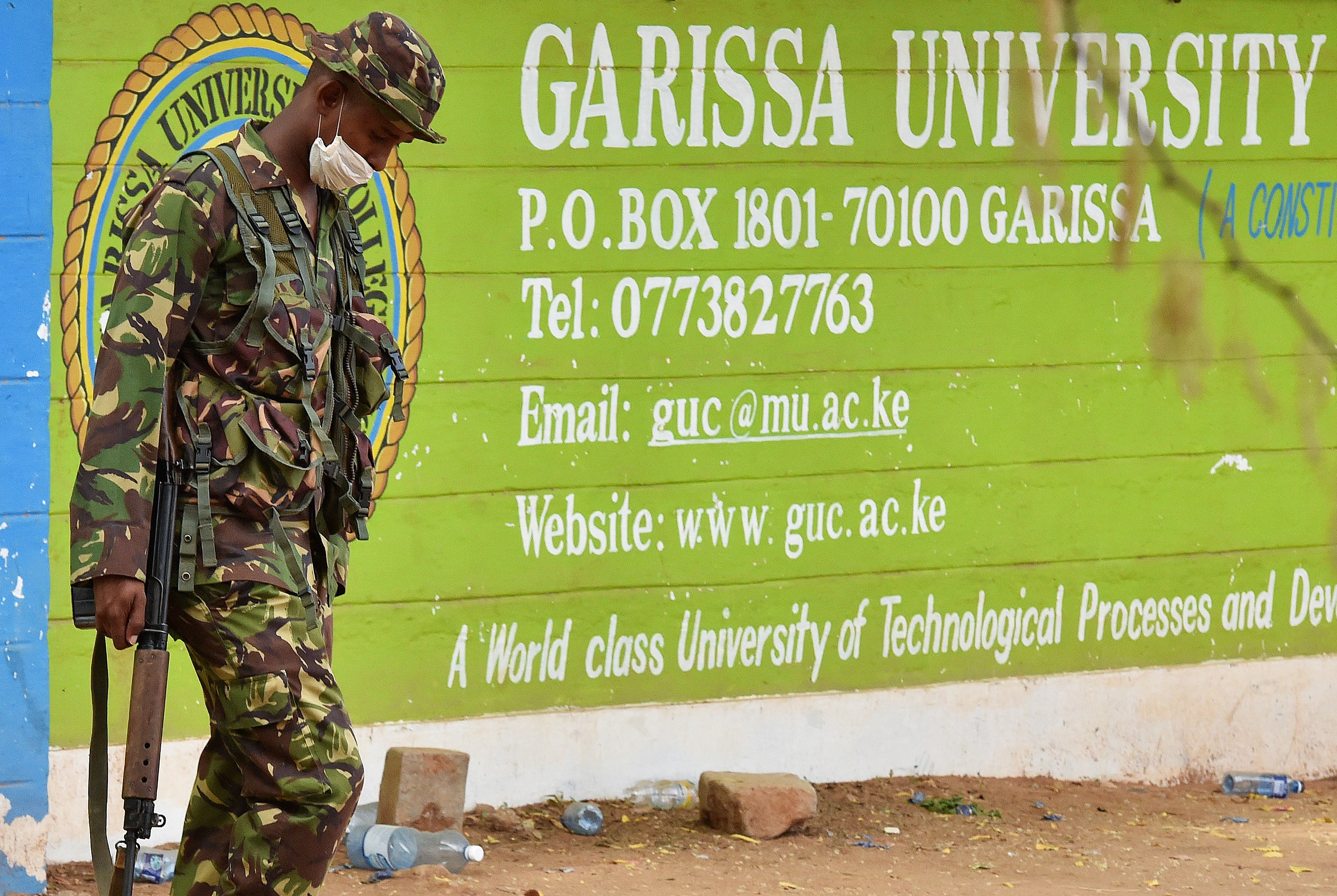 A Kenya Defence forces soldier walks past the front entrance of Moi University Garissa on April 3, 2015.  (Getty)