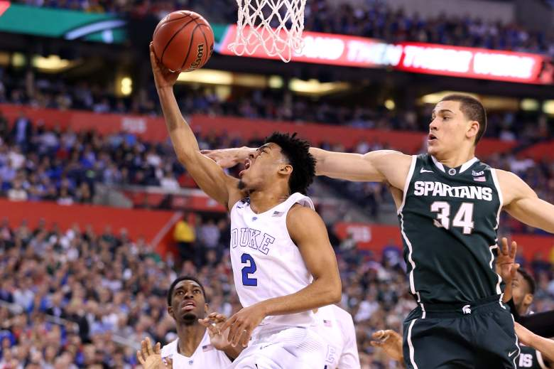 Duke's Quinn Cook goes up for the shot against Michigan State in the Elite Eight game of the 2015 NCAA men's basketball tournament. (Getty)