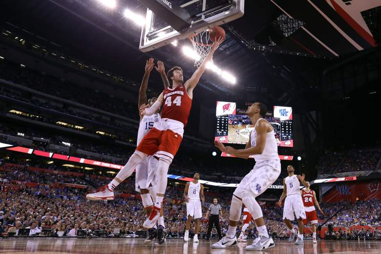 Frank Kaminsky gets to the rim late in the game as the Wisconsin Badgers win the epic rematch with Kentucky 71-64 and advance to play Duke in the National Championship Game on Monday night. Getty)