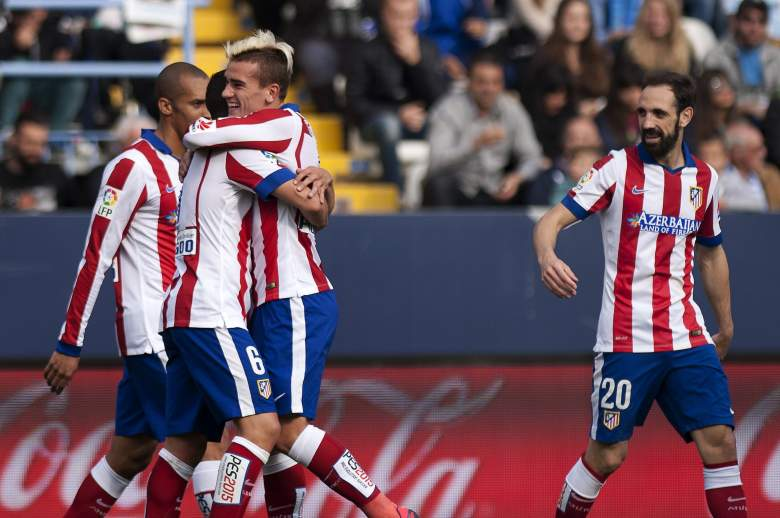 Atletico Madrid's French forward Antoine Griezmann (2ndR) will look to give his team a first leg advantage. (Getty)