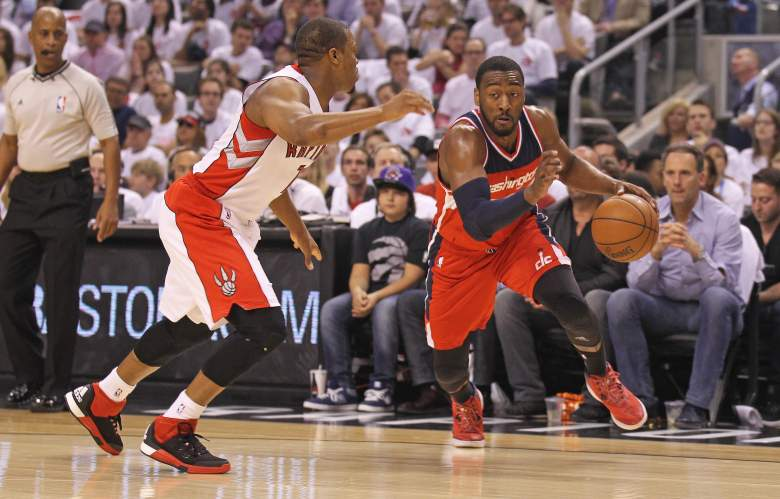 John Wall (right) and the Wizards will look to take a 3-0 lead over Kyle Lowry and the Raptors on Friday. (Getty)