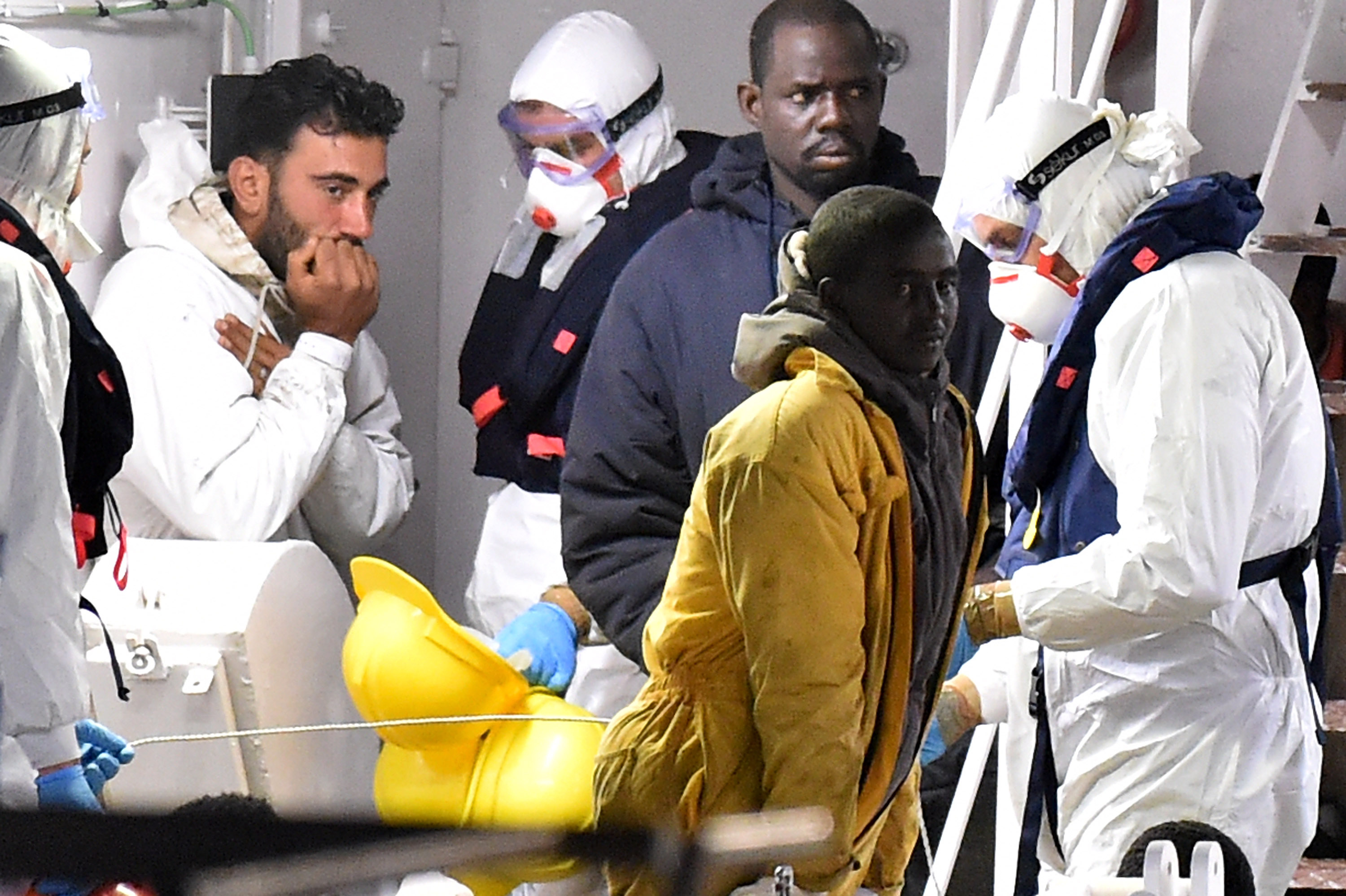Tunisian skipper Mohammed Ali Malek stands on the deck of the Italian Coast Guard ship Gregretti which is carrying 27 survivors of the migrant shipwreck in the mediterranean, at Catania port on April 20, 2015 in Catania, Italy.  (Getty)