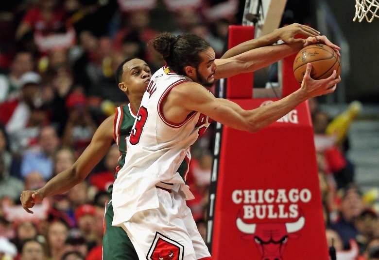 Joakim Noah of the Bulls and the Bucks' John Henson fight for the ball. (Getty)